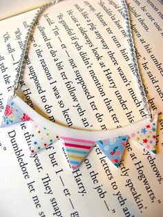 Bunting necklace. Great idea to save on hole punching.