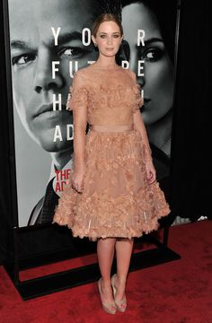 Emily Blunt Cocktail Dress - Emily donned a frothy blush cocktail dress with delicate lace sleeves and an applique texture.