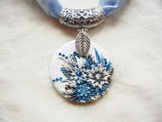use metal findings that are readily available and incorporate them with polymer clay pendant/charm