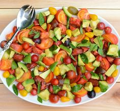 Tomato, Avocado & Basil Salad is a simple, flavorful healthy summer recipe. Gluten-free, dairy-free and paleo.