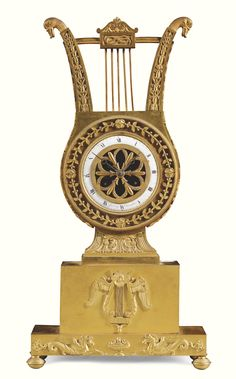 An ormolu mantel clock, Gustaf Unden, Sweden, circa 1810 3¾-inch dial with enamel chapter ring signed Gustaf Unden, pierced gilt centre, bell striking movement with silk suspension, the lyre-shaped case on a double plinth with lyre and hippocampi mounts  46.5cm. 16¼in. high Sotheby's