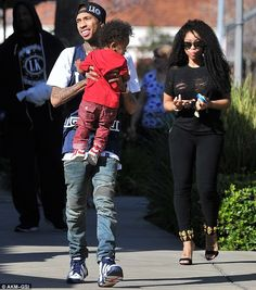 Former flame: Tyga was previously engaged to 26-year-old model Blac Chyna (right) as the t...