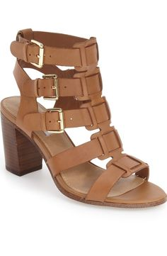 Head over heels for these rich leather sandals with laddered buckle straps for a cool caged effect.