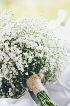 Baby's Breath Bouquet. Bridesmaids? si,ple but so pretty with a little lace added