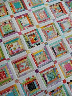 scrappy log cabin block quilt