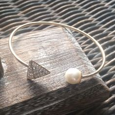 Faux Pearl & Crystal Cuff Bracelet Gold tone 2mm fashion cuff bracelet with faux pearl and clear crystal at pyramid end. The white faux pearl is approximately 9mm. Fashion jewelry, hypoallergenic, nickel free. OJ  Designs Jewelry Bracelets