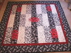 Looking for quilting project inspiration? Check out Black, Red and White quilt by member Pjmlmm. - via @Craftsy