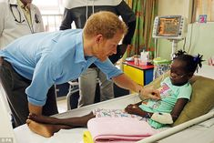 Back again: On Harry's first visit to the hospital six years ago he was pictured cooing ov...