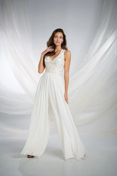 Modern, luxurious and fit for a princess of the Arabian desert, this modern chiffon jumpsuit inspired by Jasmine features an elaborately crystal beaded bodice that sparkles with the fire of true love