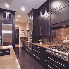 Beautiful kitchen complete with dark cabinets. www.choosechi.com