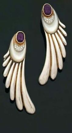 Silver, gold, pearl, diamond, amethyst earrings designed by Erté in the 1920s
