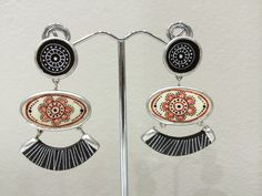 Chandelier earrings hand painted by Mambu Design , find them at our stores IndegeniusZA