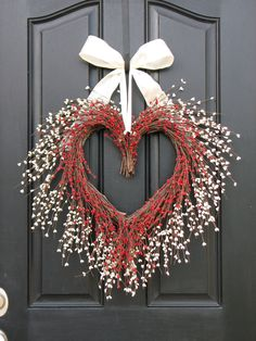Heart Wreath - take two swags of floral from craft store- tie ends together (to make center of heart) - bend swags around and down and tie at bottom - add ribbon and hang.