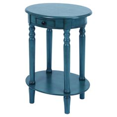 Charmingly handcrafted from mahogany wood, this stylish end table showcases turned legs and a bottom display shelf. Product: End...