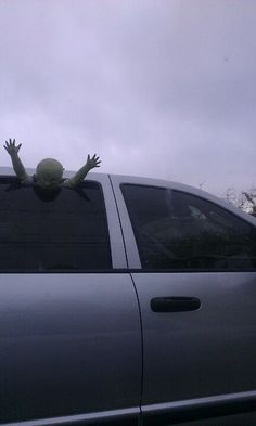 Decorated car for Halloween - this one is a little scary but I could makes witch legs hanging out the window instead