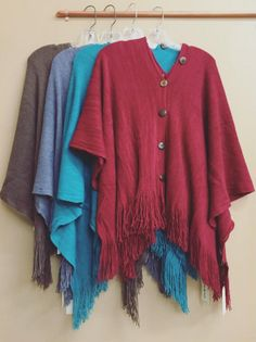 Fringed ponchos with button detailing!