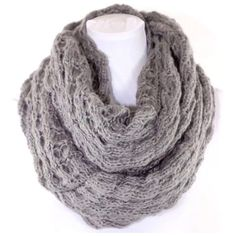 """B147 Chunky Soft Sweater Yarn Gray Infinity Scarf ‼️PRICE FIRM‼️   Sweater Yarn Double Infinity Scarf  Retail $74  Gray  This scarf is unbelievably soft & warm!  Made from the same yarn as your favorite comfy sweater!  Photos do not do justice.  Lots of stretch to get that perfect look!  Dress up any outfit day or night.  Also available in other colors. Please check my closet for many more scarves, jewelry and designer clothing items.  100% acrylic.  Length 32"""" (unstretched)  Width 14""""…"""