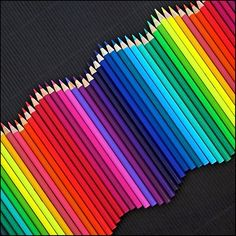 Rhythm - the colour pencils are arranged in a wave-like pattern and according to its colour gradient.