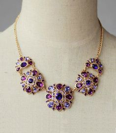 This statement necklace is chained with very good quality purple crystal pendants. It is an elegant and high-class choice. You can easily match