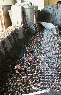 This Lord of the Rings LEGO brick build of Helms Deep is freakinmind blowing! Its amazing how epic this thing turned out! It was builtby Rich-K and Big J using 150,000 LEGO bricks and 1,700 minifigs. This might just be one of the greatest LEGO sculptsthat Ive ever seen. I would love to see what it looks like in person. This is sure to make your jaw drop.