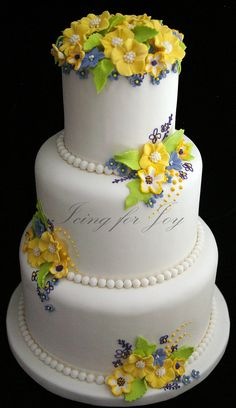 an elegant cake with just the right amount of yellow flowers. Elegant Wedding Cakes, Beautiful Wedding Cakes, Gorgeous Cakes, Pretty Cakes, Cute Cakes, Amazing Cakes, Elegant Cakes, Fondant Cakes, Cupcake Cakes