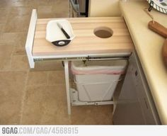 This should come standard in every house! Cutting board over trash can...genius!