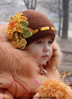 THE BEST WEBSITE ....ALL KINDS OF PATTERNS FOR LITTLE GIRL KNITTED HATS........little autumn cutie - the writing is in Russian!!