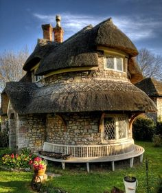 A stone thatched cottage in Blaise Hamlet near Bristol, UK.    Designed by John Nash