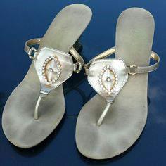 """'Onex' Gold slip on sandals Beautiful Onex sandals w/ Gold and rhinestone detail. 1.5""""  Asymmetrical heel. The Gold is a very light 'soft gold' color. Very pretty! These previously worn, they have small marks and scuffs but don't look tore up at all. Price reflects wear. Onex Shoes Sandals"""