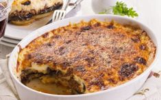 A drool-worthy dish, our Grilled Vegetarian Moussaka Recipe With Soy Granules is a layered baked dish that includes layers of roasted zucchini and eggplant slices, a lip smacking tomato basil sauce and a rich bechamel sauce, baked with a layer of cheese. Beef Casserole Recipes, Ground Beef Casserole, Casserole Dishes, Moussaka Recipe, Good Food, Yummy Food, Greek Dishes, Main Dishes, Greek Recipes