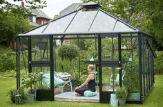 Doing yoga in She shed greenhouse by Juliana