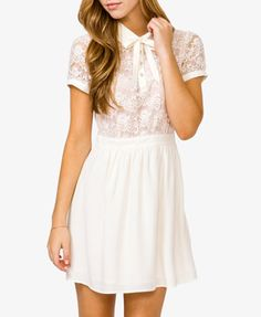 A semi-sheer dress featuring a contrast lace overlay and a rhinestone partial button placket. Peter Pan collar. Tie at the neckline. Banded cap sleeves with rhinestone buttons. Shirred waistline. Invisible side zipper. Partially lined. Woven. Lightweight.