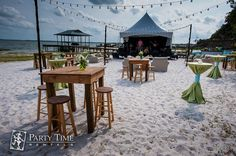 The outdoor seating at this beach wedding fit perfectly with the natural surroundings.