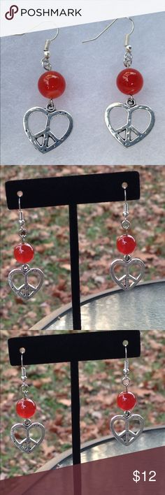 Red Carnelian Heart Peace Sign Earrings These lovely earrings are made with natural carnelian and silver tone heart shaped peace sign charms. The hooks are sterling silver plated.   All PeaceFrog jewelry items are handmade by me! Take a look through my boutique for more unique creations. PeaceFrog Jewelry Earrings