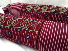 Vintage Guatemalan huipil textile transformed into bolster pillows