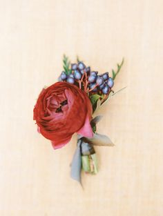 Rich colored boutonniere: http://www.stylemepretty.com/2014/10/17/elegant-estate-wedding-inspiration-part-1/ | Photography: Marisa Holmes - http://marisaholmesblog.com/