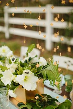 gold hanging four leaf clovers, photo by Sara and Rocky, styling by Birds of a Feather Events http://ruffledblog.com/st-patricks-day-wedding-ideas #weddingideas #green #stpatricksday