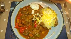 Beef Stew Chilli with Baked Potato, Cheese and Quark.