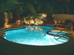 Pool with jacuzzi and water feature