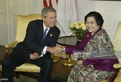 US President George W. Bush (L) meets wi Pictures | Getty Images
