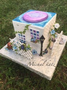 sweet house and forget me not flowers - Cake by michal katz