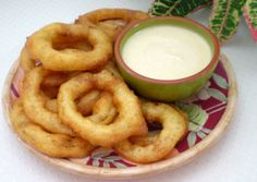 Caribbean Lime Onion Rings With Spicy Dipping Sauce from Food.com:   								A delicious poolside snack - or a great accompaniment for a barbecue. These tangy onion rings are delicious served with the spicy lime dip. I have also used low-fat mayonnaise, in an attempt to lighten the calories!