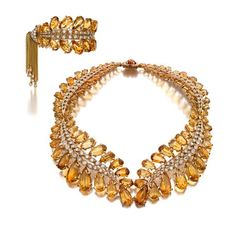 a citrine and diamond suite by Sterlé, circa 1950.  Rarely is citrine featured so prominently in a piece of jewelry and even more seldom is it accomplished as beautifully as this demi-parure from Parisian jeweler Pierre Sterlé.