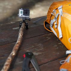 Attach go pro to stick to get a different perspective while filing your camping trip.