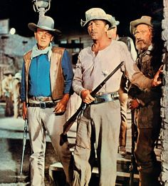 """Duke with Robert Mitchum, Arthur Hunnicutt and James Caan (almost hidden in the background) in the thoroughly enjoyable and satisfying """"El Dorado"""" (1967)."""