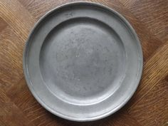 Antique French medium Pewter Etain dish tray charger platter plate serving table display old aged used circa 1850-1900's Purchase in store here http://www.europeanvintageemporium.com/product/antique-french-medium-pewter-etain-dish-tray-charger-platter-plate-serving-table-display-old-aged-used-circa-1850-1900s-2/