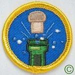 Champagne Merit Badge