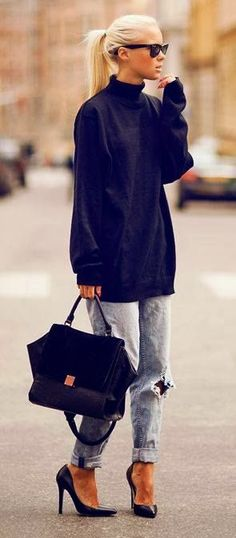 oversized black turtleneck, light wash distressed boyfriend jeans, black heels and black tote
