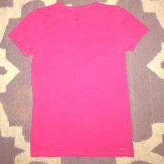 Calvin Klein Pink T-Shirt w Logo Calvin Klein Pink T-shirt (xtra comfy Bc it's tag is printed on back of neck no pesky tag to mess with) Also there's a Silver Reflective Calvin Klein Logo on bottom Right of shirt in front. This T has never been worn. Tags removed & washed. That's it. And would be cute w jeans, leggings working out, boxer short or your fave yoga pants to sleep in? Or throw on some black leggings grey booties or some tennis shoes & you have a gr8 nice, HUGHEND look 2 go?…