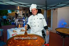 Chef Garcia #cooking Paella and Arroz Campesino for birthday party .